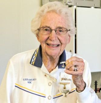 """Turramurra Patron Phyl Gregg displays her """"Star Veteran"""" badge."""