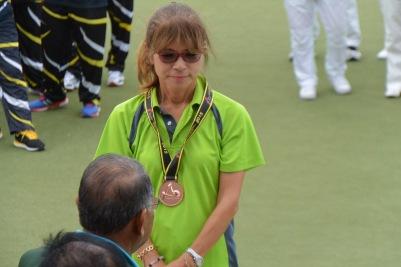 Midori receiving her Bronze Medal