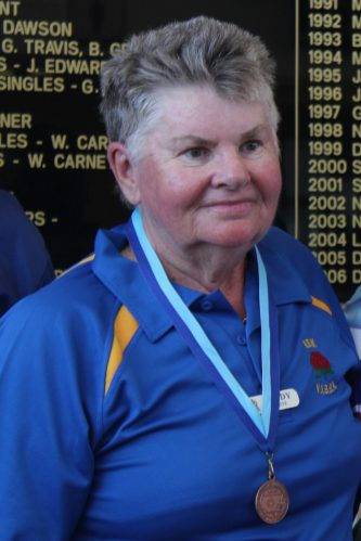 Sandy White proudly wearing her Bronze Medal